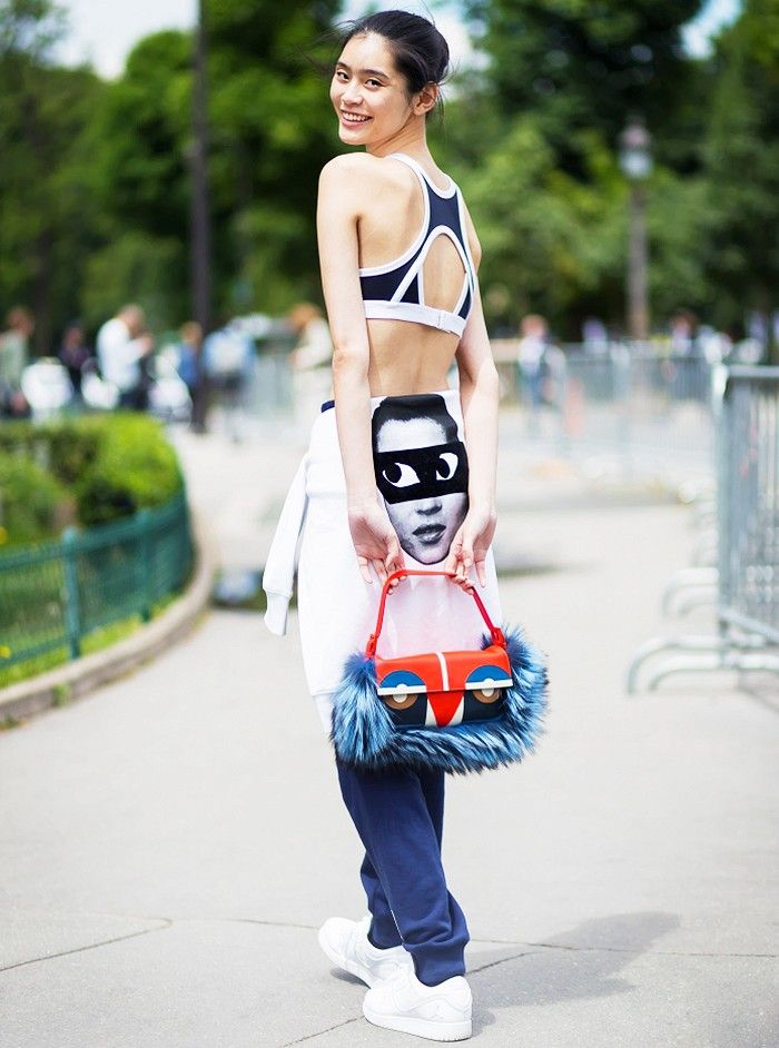 Ming Xi with furry Fendi purse via whowhatwhere